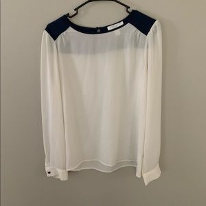 White and navy blouse
